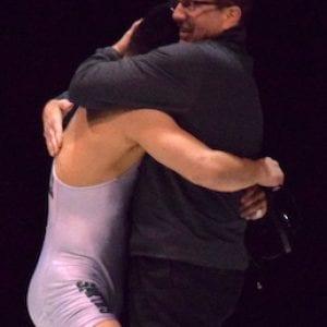 Omania embraces De La Salle coach Mark Halvorson in the wake of his gold medal victory. CIF State Wrestling Championship